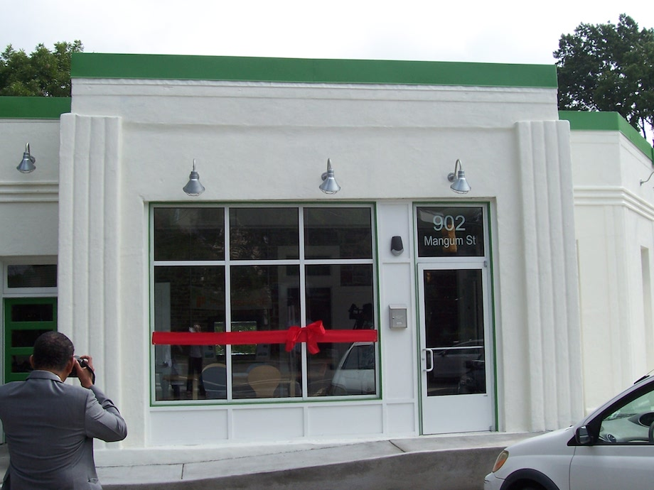 Senator Floyd McKissick takes a picture of the Sparking Storefront at the Grand Opening on Thursday, September 10th